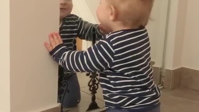 baby talks to reflection