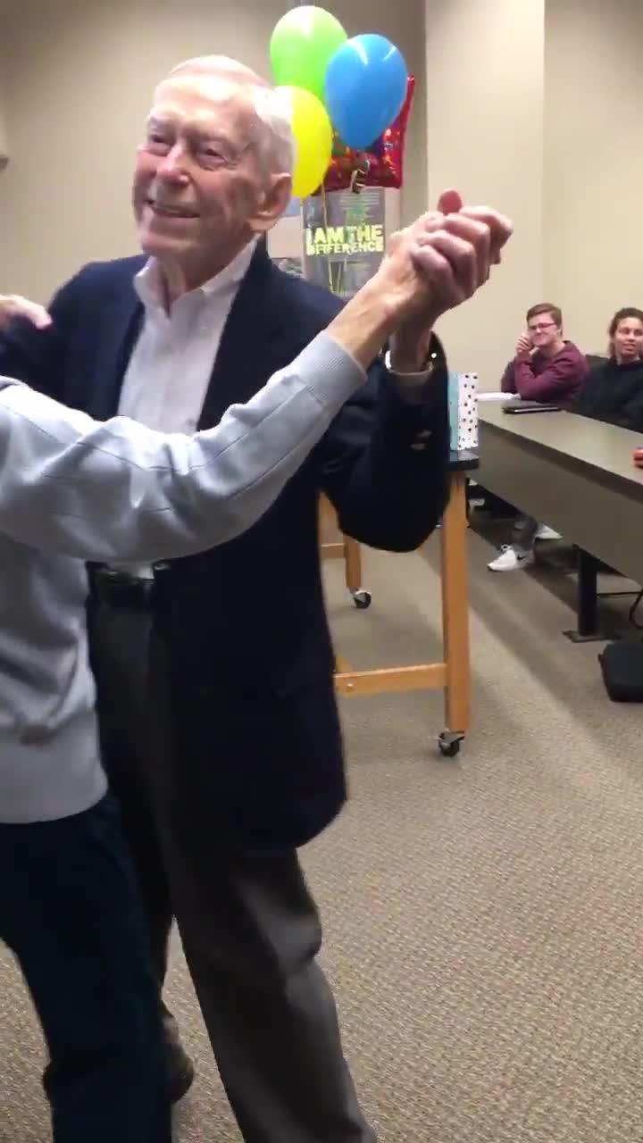 adorable elderly couple dance