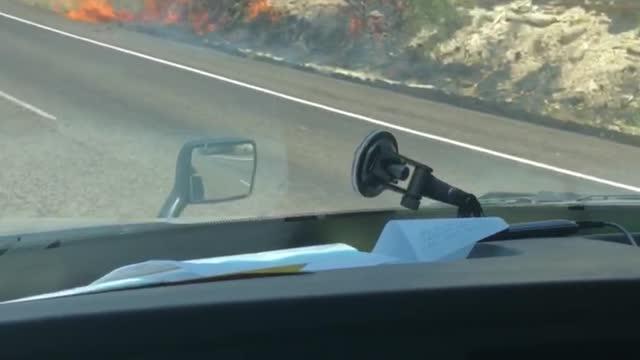 Truck Fire Spreads Along Shoulder