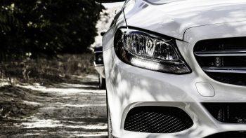 front of a mercedes car